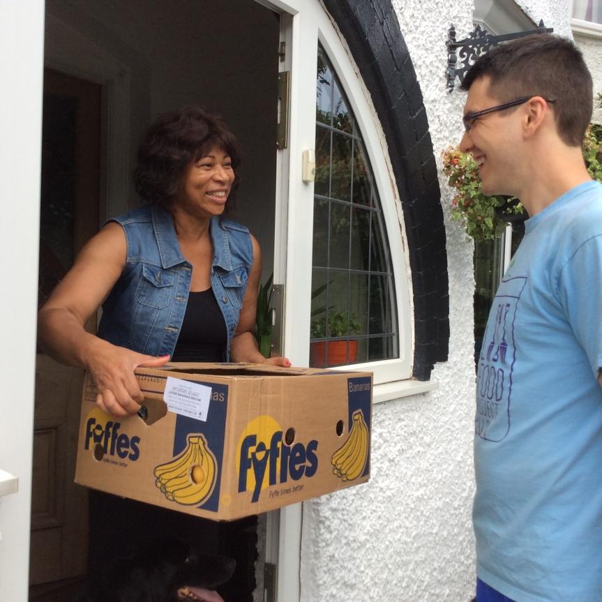 Marva receiving her 'Freegan Box'
