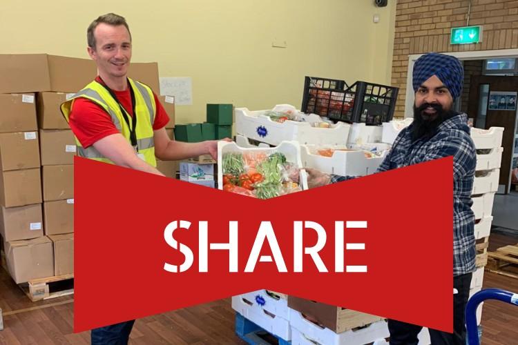 Volunteer receiving a pallet of donated surplus