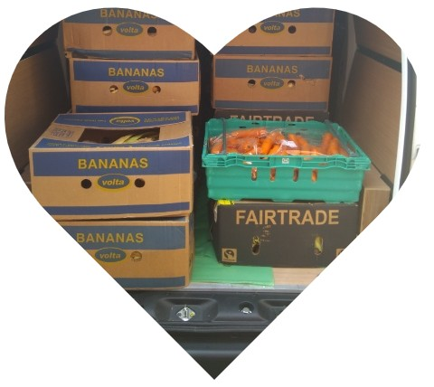 Boxes of bananas and carrots