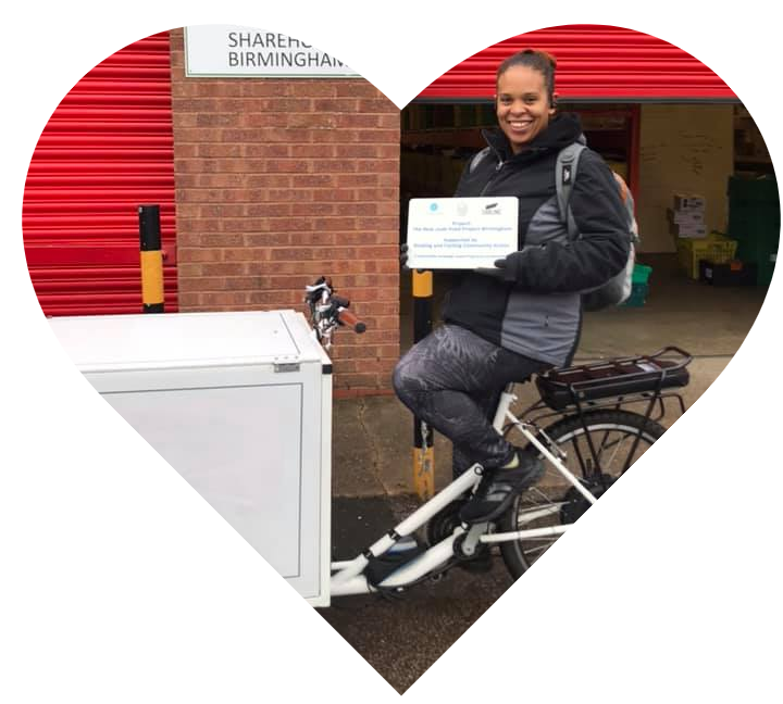 Heart showing a volunteer riding a cargo trike