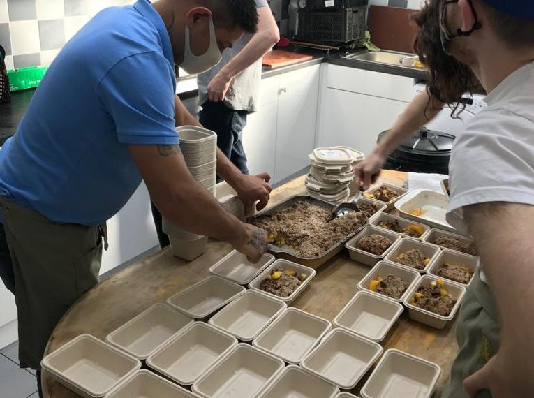Residents fill individual takeaway boxes