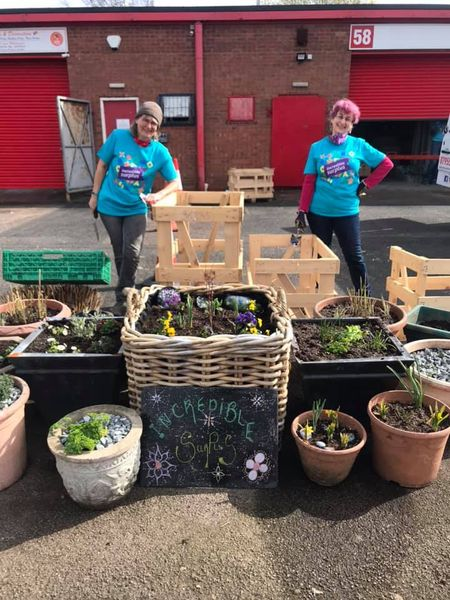 Volunteers gardening at the Sharehouse